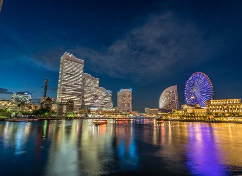 Yokohama, Kanagawa, Japan - July 31, 2017 : Blue hour colorful sunset skyline view at Yokohama port Minato Mirai 21 seaside buildings. (Port of the future)