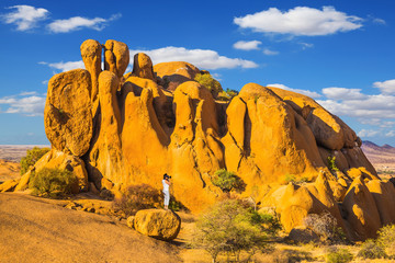 Slender woman in the Namib desert