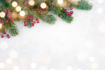 Christmas background design with decorated fir tree branch and snow