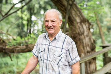 Senior man in the nice forest park
