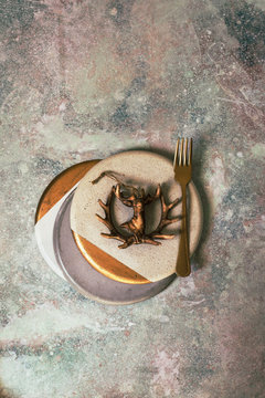 Christmas table set, plate decorated with the figure of a deer