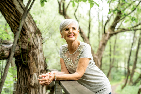 Senior woman in the nice forest park