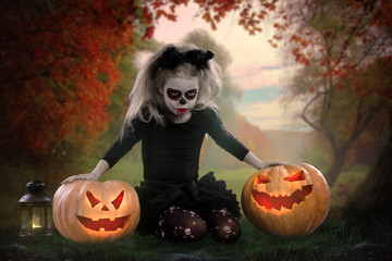 dracula child.little girl with halloween make-up . the image of the devil with horns