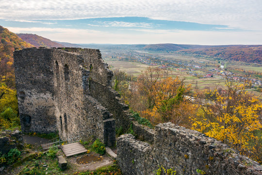 view from the wall of Nevytsky castle in to the valley with Kam'yanytsya village. wonderful autumn adventure