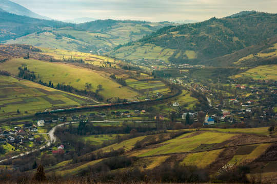 village in the valley. bird eye view. rail road and viaduct in the distance. mysterious autumn weather