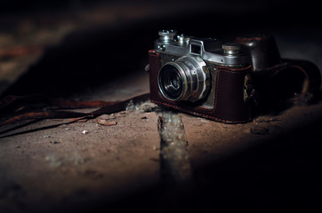 vintage film camera on wooden floor