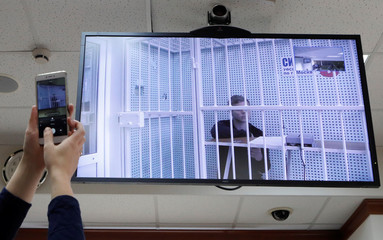 Russian soccer player Kokorin is seen on a screen via a video link during a court hearing in Moscow