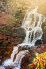 waterfall Shypot in gorgeous evening light. beautiful autumn scenery of Carpathian nature wonders