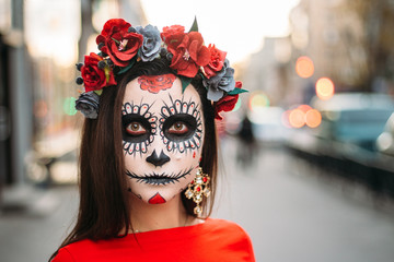 portrait of a girl in the city with a make-up, make-up for halloween, day of the dead, zombies. dead among us, ghost. walk of skeletons