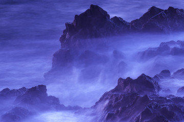 Water with rock nature photo with long exposure fog effect abstract color ocean background