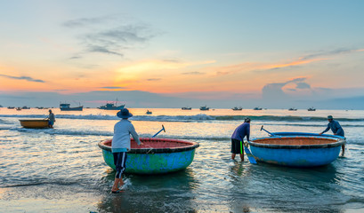 Mui Ne, Vietnam - September 28th, 2018: Pier fishing at Mui Ne beach in the morning when the fishermen prepare for a trip out to sea full of fish caught in Mui Ne, Vietnam
