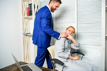 Boss unacceptable behavior with subordinate employee. Boss touch shoulder of female office colleague. Tired woman worker relaxing while man massaging her. Behavior rule and subordinate at work