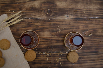 biscuits with two glasses of tea on wooden table as chat place