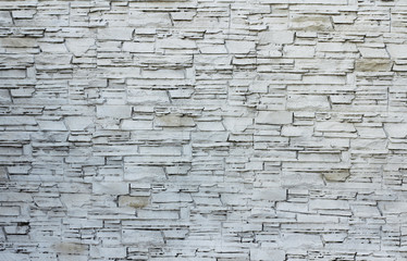 Background of stone wall texture photo. White gray bricks.