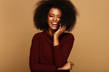 Wall Mural - Portrait of laughing african american girl with copy space