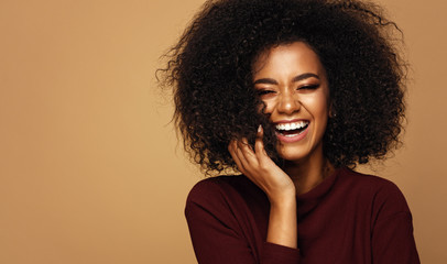 Portrait of laughing african american girl with copy space