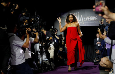 Naomi Osaka of Japan arrives for the singles draw ceremony of the WTA tennis Finals in Singapore