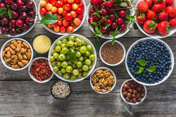 Healthy food selection, nuts, fruits and assortment of superfoods, top view Fototapete