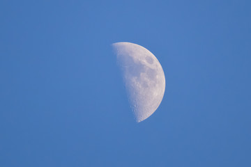 the Moon in blue sky
