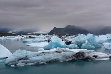Blue icebergs in Jokulsarlon glacial lagoon at sunset. Vatnajokull glacier, southern Iceland