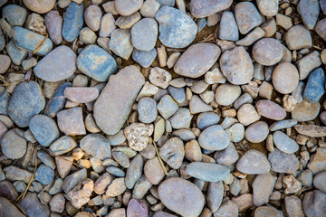 Sea pebbles. Small stones gravel texture background.Pile of pebbles, thailand.Color stone in background.