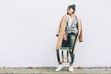 Wall Mural - Street fashion look. Female multilayered outfit for autumn days
