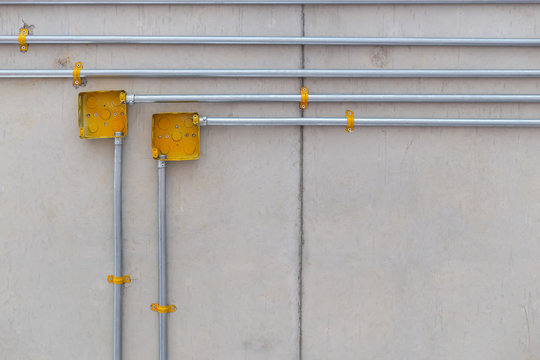 yellow electric box and pipe