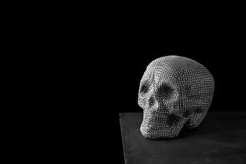sparkly skull against a black background