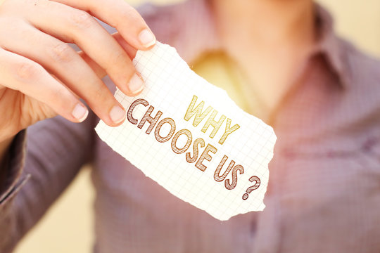 business woman holding tear paper with why choose us ? text