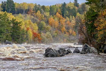 Beautiful rushing river rapids at Jay Cooke State Park in the Autumn season