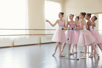 Ballerinas having break in practice at ballet studio