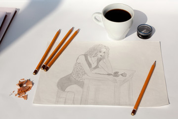 Pencil drawing girl with rose, pencils, pencil sharpener, cup of coffee on a table on a white background