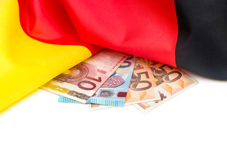 German flag with euro bills on white.