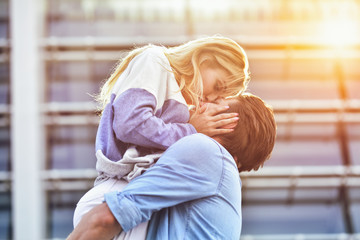 Attractive boy and girl hugging and kissing.