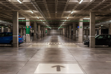 Directional arrows in underground shopping center parking.