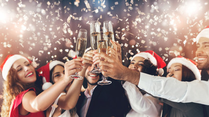 Diverse friends clinking with champagne glasses on New Year's Eve