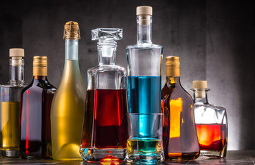 Poster Alcohol Carafe and bottles of assorted alcoholic beverages.