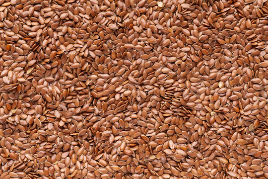 Close up of brown flax seeds background