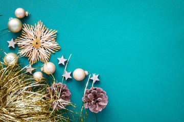Christmas decoration background turquoise with straw star