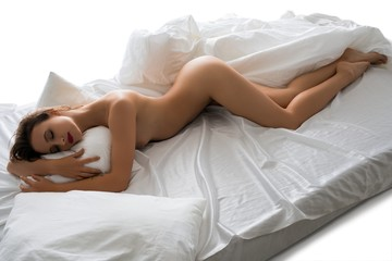Nude girl lying in bed high angle isolated view