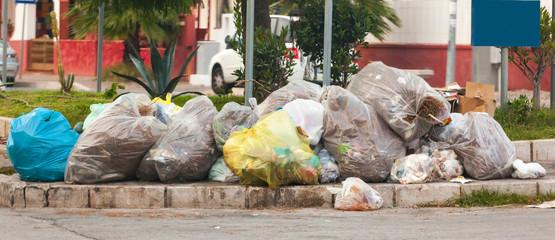 Waste bags in the street on the sidewalks