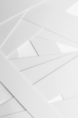 Low geometric composition with white elements, abstract background