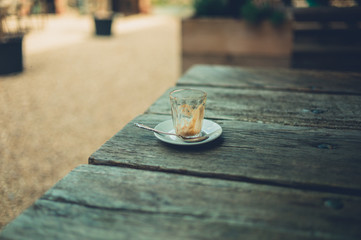 Empty espresso cup on table outside