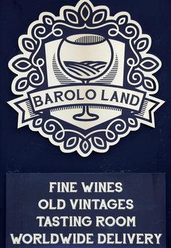 A wine shop logo is seen outside the shop in Barolo
