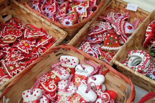 Advent in Zagreb, Croatia. A vendor selling hand made Christmas decorations with traditional Licitar heart symbol of Zagreb