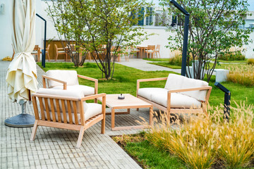Outdoor patio with wooden armchairs and table