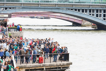 Big crowd of tourists on London's South Bank.