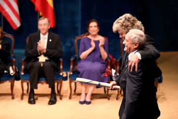 Mountaineers Reinhold Messner and Krzysztof Wielicki embrace after receiving the 2018 Princess of Asturias award for Sport from Spain's King Felipe, during a ceremony at Campoamor Theatre in Oviedo