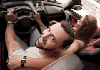 top view.a young man and his girlfriend in a convertible
