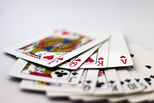 Nottingham,England,UK - 30/08/2018 Playing Cards - Queen, King, Jack, Ace from each Suit fanned out across back of cards,